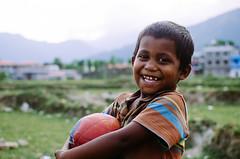 Laughter - better than gold (酷哥哥) Tags: nepal portrait smile kids ball children village mark soccer twain nepalese pokhara primaryschool laugher vsco nikond300s