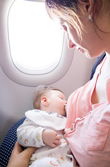 AFS-140342 (Alex Segre) Tags: travel 2 two woman baby travelling public plane out children airplane outside outdoors cabin women infant babies child place outdoor interior board small transport mother going places aeroplane mum human journey transportation inside months breastfeeding traveling infants month caucasian on in modelrelease a alexsegre