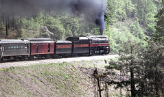 Southern Railway operated Norfolk & Western J-class 4-8-4 Northern steam locomotive # 611, is seen from onboard a railfan excursion train while rounding a curve and traveling from Atlanta to Toccoa, Georgia, May 1983 (alcomike43) Tags: old people color classic modern vintage ties georgia photo nw engine photographers slide trains historic photograph rails artdeco locomotive streamlined northern sr engineer tender steamengine railroads 611 ballast rightofway norfolkwestern southernrailway steamlocomotive 484 mainline passengertrains roadbed passengercars railfans jclass railfanexcursiontrains auxiliarywatertender