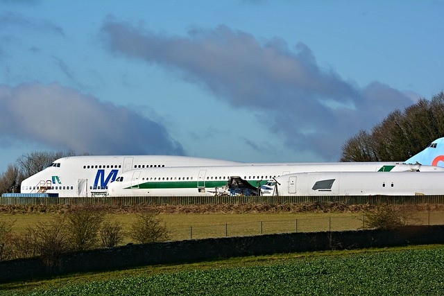 TF-AME Med-View / Air Atlanta Icelandic Boeing 747-312 with Alitalia Airbus and Boeing 737 fuselages at Cotswold Airport / Kemble