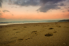 Newgale beach, footprints (AndrewJAA) Tags: ocean sunset sea reflection beach water wales night sand surf waves exploring tide tourist pembrokeshire shimmer visitwales