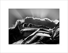 End of an era (tkimages2011) Tags: sky car metal clouds mono monochromatic scan rays wreck scrap