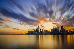 Sunset from The Pier (Jared Ploughman) Tags: city longexposure sunset urban orange sun toronto ontario canada water clouds pier nikon cntower dusk cityline polson ndx400 d7000