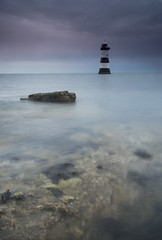 Penmon, Anglesey (RHughes5) Tags: sea lighthouse water rock clouds landscape coast still nikon long exposure waves peaceful filter grad penmon d3200