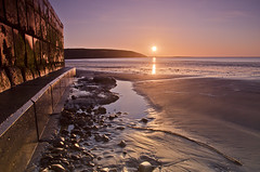 Filey, coble landing at sunrise (Elise NOT Elsie) Tags: uk england seascape water wall sunrise seaside waves calming sunny pebbles coastline puddles northyorkshire filey coblelanding