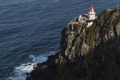The Lighthouse Ponta do Arnel (Steve Vallis) Tags: ocean cliff lighthouse portugal rock azores