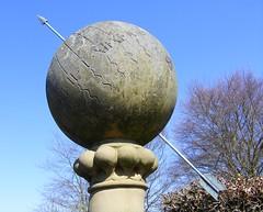 Shot through (leedslily) Tags: blue sky sculpture tree stone ball garden spring yorkshire column arrow plinth yorkgate