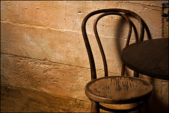 Solace (Junkstock) Tags: old wall concrete photography photo cafe chair decay rustic photographs photograph americana weathered distressed decayed patina relic oldstuff respite solace oldusedobjects altebenutztegegenstände