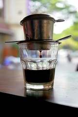 Vietnamese coffee (radimersky) Tags: hot glass coffee lens lumix milk asia vietnamese with style drop panasonic vietnam micro po pancake 20mm condensed 43 teaspoon kawa ni kropla wietnam sweetened szklanka mleko h azja gorca yeczka dcmgf1 wietnamsku skondensowane szklaneczka