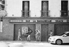 La Bananeraie (Jim Davies) Tags: people bw france film monochrome 35mm blackwhite olympusstylusepic streetphotography ishootfilm xp2 analogue provence eze southoffrance ilford alpesmaritimes c41 chromogenic olympusmjuii filmfilmforever