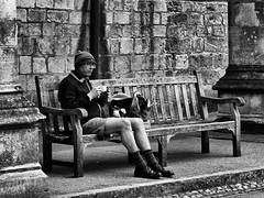 Lunch (Reinardina) Tags: england people blackandwhite man monochrome hat bench lunch person glasses peace cathedral outdoor candid drinking streetphotography hampshire medieval beanie winchester bankholiday alfresco