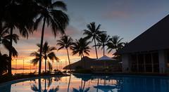 Hamilton Island Sunrise (oppie76) Tags: ocean roof reflection water pool clouds sunrise islands chairs australia resort hills palmtrees tables queensland umbrellas hamiltonisland whitsundayislands canoncamera boatmasts ef24105mmf4isusm passagepeak sailsrestaurant eos5dmk3