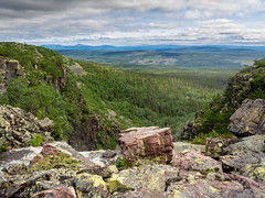 Far Away (Jens Haggren (off for a while)) Tags: trees sky mountains clouds river landscape rocks view sweden olympus dalarna em1