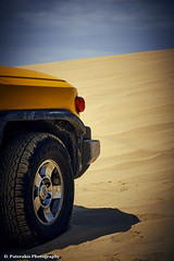 Desert safari (Paterdimakis) Tags: road travel blue sky motion color car wheel yellow sand desert machine chrome arabia
