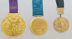 Trio of Olympic Gold Medals (Digital Zoetrope) Tags: olympics olympicgoldmedal