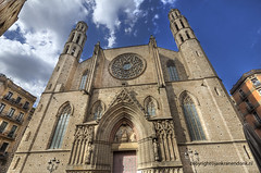 Cathedral of the Sea (Jan Kranendonk) Tags: barcelona door city travel sea summer sky urban sculpture building tourism church clouds facade religious mar spain ancient europe cathedral cloudy famous religion gothic central scenic entrance culture sunny landmark medieval spanish catalunya hdr catalan