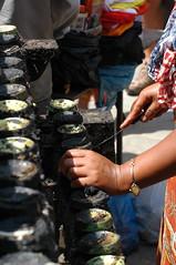 cleaning the racks of oil lamps (cam17) Tags: nepal kathmandu durbarsquare oillamps lampcleaner durbarkathmandu rackcleaner
