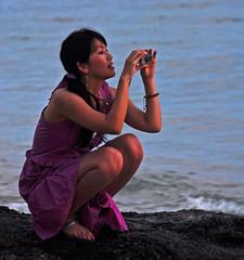 Purple Sunset (Ctuna8162) Tags: camera sunset woman sun beach asian hawaii sand pretty photographer waikiki oahu tourist honolulu