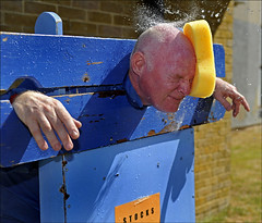 100710.014. 'Splatt Adian'.  (THDS100710garlinge-7.) (actionsnaps) Tags: man water kent adult spray stocks familyfun splash captive highstreet fundraising throwing eyesshut baldhead thanet restrained redface charityevent communityevent pillory garlinge directhit closeeyes policecommunitysupportofficer kentpolice wetsponges garlingeresidentsassaciationsummerfair garlingemethodistchurch splattadrian pcsoadrianbutterworth