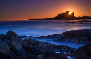 Bamburgh Castle, Northumberland coast at sunrise. England, UK.