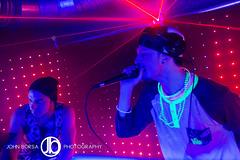 DJ on the Mic (JohnBorsaPhoto) Tags: life light party music records color beautiful club night dark happy lights beads dance sticks buffalo eyes closed neon dj noir glow floor dancing spin happiness partying nightclub led mc enjoy record microphone rave stick glowing dancefloor nightlife glowstick mic raver edm enjoyment glowsticks raving emcee chippewa noirultralounge