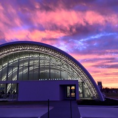 OKC Fitness Center (SteelMaster Buildings) Tags: city pink roof sunset building oklahoma skyline architecture night purple outdoor dusk steel center activity ok fitness gym physical quonset
