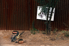 A Chainsaw, A Copper Pot, and a Sign (lars hammar) Tags: arizona sign fence tucson chainsaw copper corrugated copperpot barrioviejo corrugatedmetal