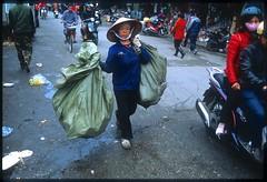 Taking out the trash (jeremyhughes) Tags: street urban woman film trash work 35mm nikon asia fuji market working streetphotography slidefilm vietnam litter busy transparency rubbish nikkor hanoi provia f90x trashbags 35mmf2d dongxuanmarket hni chngxun