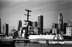 LA on Ilford Delta film (Drew Gallegos) Tags: california city sky urban blackandwhite film skyline architecture skyscraper landscape la landscapes blackwhite losangeles downtown canonae1 dtla bnw ilforddelta100 filmisnotdead