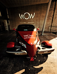 A Car to Wow You (Steve Taylor (Photography)) Tags: design sign advert building museum column brown red newzealand nz southisland shadow car auto automobile sunny sunshine bumper nelson worldofwearableartandcollectiblecars wow flamboyant radiator grill custom