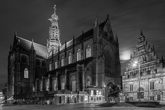 Gothic Haarlem (McQuaide Photography) Tags: haarlem noordholland northholland netherlands nederland holland dutch europe sony a7rii ilce7rm2 alpha mirrorless 1635mm sonyzeiss zeiss variotessar fullframe mcquaidephotography adobe photoshop lightroom tripod manfrotto availablelight night nacht nightphotography longexposure stad city urban lowlight outdoor outside architecture building gebouw monochrome mono blackwhite bw blackandwhite classic authentic moon maan oldbuilding gothic gothicarchitecture church kerk square grotemarkt grotekerk stbavo stbavokerk landmark religiousbuilding religion christianity exterior northernside marketsquare history historical vleeshaal museum museumdehallen wideangle wideanglelens groothoek