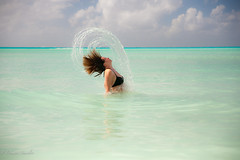 playing in paradise (Dimitri_Stucolov) Tags: playing movement paradise bahamas highspeed waterhair hairflick