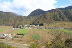 Collective Farm and Monument near Chonnyul (multituba) Tags: northkorea dprk