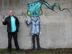 'Selfie' in Aqua (HereInVancouver) Tags: city urban streetart canada art vancouver aqua bc tripod publicart selfie ireallylikethisguyswork whataretheoddsthatiwouldbewearinganaquashirtwhenihappeneduponthispainting