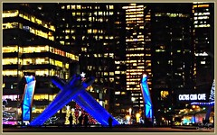 Theme 47 - City Lights (supe2009) Tags: christmas plaza city blue trees winter people canada colors skyline club night vancouver buildings stars fun lights star downtown shadows bc waterfront landmark center special torch citylights convention burrardinlet tradition icy magical cauldron poole symbolic glassfixture hostcity permanentfixture olympiccauldron photobysue touriest catusclub jackpooleplaza themebysharleen