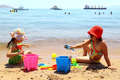 Childhood, Sun, Sand and Water...... nothing beats that (Majd Selbi) Tags: beach children sand jordan aqaba