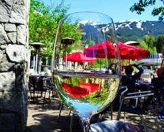 Cheers! (+2) (peggyhr) Tags: blue trees red white snow canada mountains green reflections whistler bc bokeh refraction wineglass umbrellas skiruns thegalaxy dappledsunshine peggyhr outerpatio thegalaxyhalloffame thelooklevel1red ♣myhatsofftoyou super~sixbronze☆stage1☆ dsc05197a