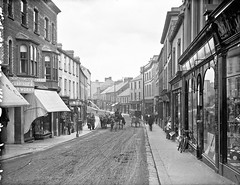 Church Street, Ballymena, Co. Antrim (National Library of Ireland on The Commons) Tags: hardware compton reid shops hosiery montgomery churchstreet ballymena johnston mcdowell countyantrim glassnegative rakes robertfrench williamlawrence nationallibraryofireland lawrencecollection lawrencephotographicstudio thelawrencephotographcollection mcdowellsboots carriageandcarworks