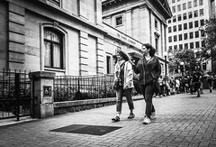 Faire Une Promenade (TMimages PDX) Tags: road street city people urban blackandwhite monochrome buildings portland geotagged photography photo image streetphotography streetscene sidewalk photograph pedestrians pacificnorthwest avenue vignette fineartphotography thepioneercourthouse iphoneography