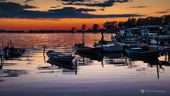 Night falls (nikhrist) Tags: sunset sea orange boats evening lagoon greece nightfalls messolonghi goldcollection aetoloakarnania nickchristodoulou