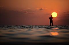 [ L'arroganza di Laomedonte - Laomedon's arrogance ] DSC_0559.3.jinkoll (jinkoll) Tags: sunset sun sea water waves man silhouette surreal sky clouds standing reflections horizon tropea calabria surfboard
