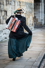 Musician in a hurry (Ruth Flickr) Tags: music woman building london tower hat towerbridge river ceramic costume accordion skirt historic installation poppies instrument remembrance bonnet toweroflondon tompiper paulcummins bloodsweptlandsandseasofred 888246