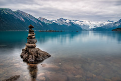 Rock Piles (`James Wheeler) Tags: travel blue sunset summer sky mountain lake canada black reflection green tourism nature water beautiful beauty rock stone clouds forest landscape whistler peace natural symbol outdoor britishcolumbia vibrant scenic peaceful tranquility peak nobody calm hike stack pebble pile shore zen destination balance relaxation tranquil stacked pristine garibaldipark stability
