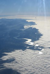blanket of low cloud (squeezemonkey) Tags: cloud sunlight alps clouds river landscape switzerland aerialview