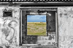 Square Window  ( Explore ) (Jez22) Tags: old england copyright color colour building beach window architecture square landscape photography coast kent fisherman view desert hut photograph frame weathered dungeness derelict isolated fishermens jez selective jeremysage