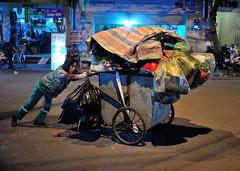 Nocturnal labour (jeremyhughes) Tags: street urban woman night trash work wagon 50mm nikon nocturnal labor working vietnam nighttime labour cart refuse nikkor hanoi hardwork manuallabour manuallabor 50mmf14d womanatwork d700