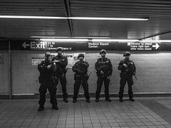 On Guard (C@mera M@n) Tags: city nyc newyorkcity people urban blackandwhite ny newyork monochrome us newjersey unitedstates manhattan police nypd places pennstation newyorkphotography