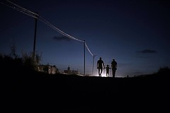 A Palestinian family members are walking in the dark while there's no electricity in Gaza (TeamPalestina) Tags: sunset sky sun sunrise landscape landscapes photo am amazing nice photographer natural sweet live palestine comfort sunrays gaza beautifull palestinian  landscapecaptures