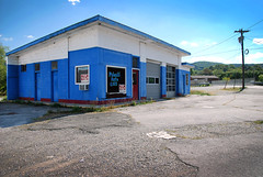 Auto Garage (whitneygraphics) Tags: auto door old blue white mountain mountains abandoned vintage pavement empty country gravel