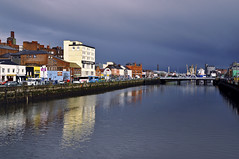 The calm before the storm (Paulina_77) Tags: city travel blue ireland light shadow sky urban irish sun sunlight seascape storm reflection building yellow skyline architecture clouds facade fence buildings reflections river dark landscape mirror golden town canal nikon colorful europe mood moody cityscape angle bright outdoor vibrant cork rich wide shoreline creative vivid atmosphere sunny stormy scene reflect filter lee hour colourful nikkor sunlit polarizer picturesque hdr atmospheric circular 18105 mirroring hff d90 marumi irlandia 18105mm nikond90 nikkor18105mm marumidhg 18105mmf3556 nikkor18105mmf3556 pola77